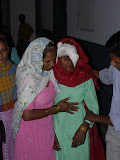 A village woman is helped to the recovery room.