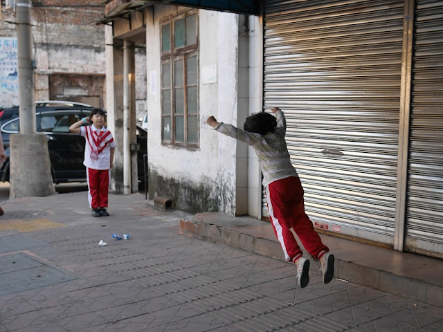 girl leaping in Shaoguan, Guangdong