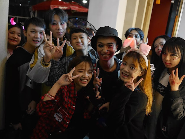 group of young people in Shaoguan dressed up for Halloween