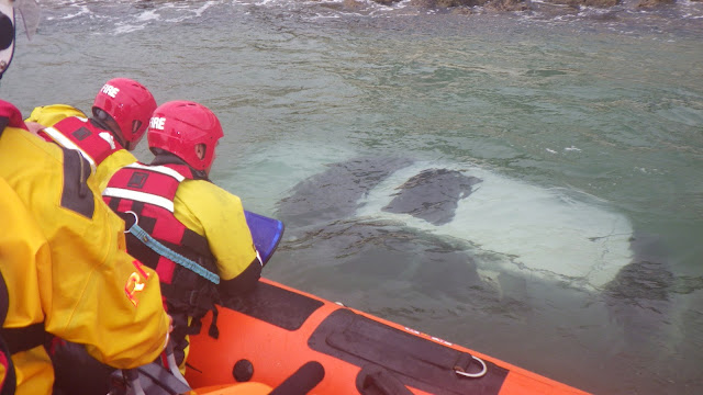 The ILB is positioned close to the submerged vehicle, so the fire crew can get a better look - 27 October 2014.  Photo credit: RNLI/Poole