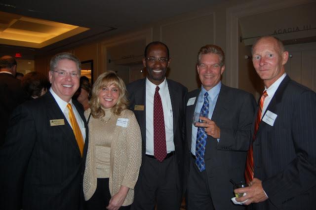 Larry Medley, JA Board Member, Lesley Medley, Hudson Rogers, JA Board Member, and Guests