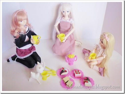 The two ball jointed dolls, the smaller doll and the deer doll all sitting down to have some tea and snacks.