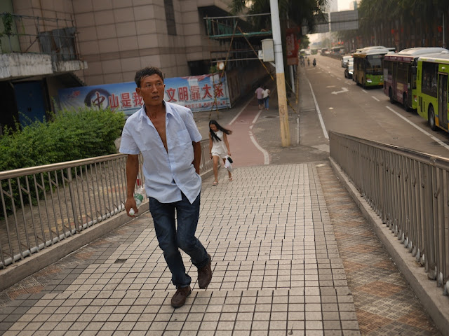 man walking up stairs for a pedestrian bridge in Zhongshan, Guangdong
