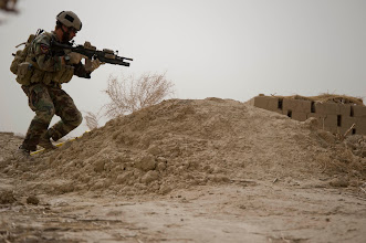 Photo: A U.S. Special Forces Soldier assigned to Special Operations Task Force – South sets up his security position during a patrol Feb. 25, 2011 in Panjwai District, Kandahar Province, Afghanistan. The SOTF-South Special Forces team in the area conducts regular patrols in order to bolster security as well as to meet with area villagers to assess development projects.    (U.S. Army photo by Sgt. Ben Watson)(Released).