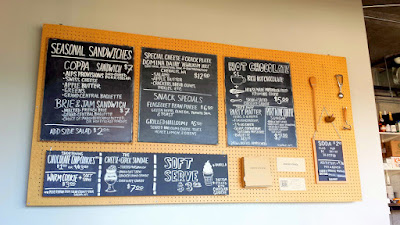 Cheese & Crack Snack Shop in Portland, on SE 28th just a few steps south of Burnside. This is their specials board, they also have a printed menu with more cheese delights