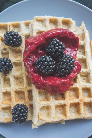 healthy banana waffles with blackberry sauce