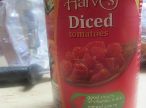 Drain 1 can of diced tomatoes of most of the liquid, but leave some...