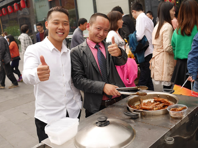 two men selling pig and chicken feet in Changsha