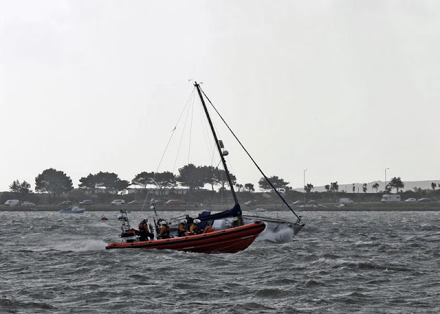 Poole ILB moves alongside the stricken yacht and helps set up a towline - 27 October 2013.  Photo credit: Mike Millard