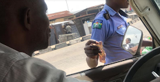 Policeman caught on camera collecting bribe