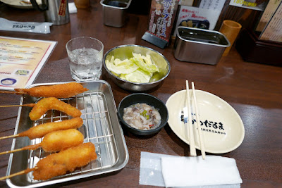 Kushikatsu lunch for me at Kushikutsu Daruma - I picked the Takowasa, which is cold octopus with rice vinegar, sugar, and wasabi as the included side for the set. Having as a side the chilled raw octopus (almost like a ceviche) with bit of acid and bite of spiciness was I thought a good counter for the deep fried fattiness of the skewers. This is part of the Shinsekai set menu that includes classic kushikatsu (beef), all natural shrimp, quail egg, asparagus, rice cake, pork cutlet, pumpkin, cheese, and tomato. The glass is NOT water - it's Kushikutsu Daruma barley shochu