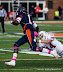 Terry Hawthorne #1 tries to run back a kick, but is caught by Nick Stoner #14 (NCAA Football: Illinois 17 vs. Indiana 31, October 27, 2012, Memorial Stadium, Champaign, IL)