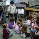 Docent Amy Clarke shares artifacts with Bloomfield Hills kindergarteners.