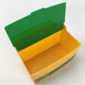 salt cellar in yellow and green open