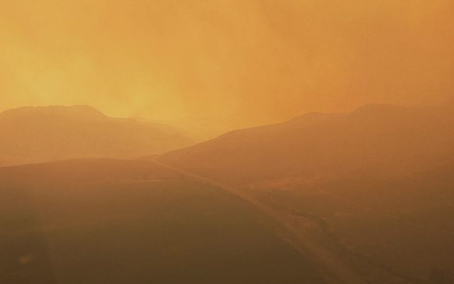 Aerial view of the 'apocalyptic twilight' conditions firefighters are working through in British Columbia, 9 August 2017. Photo: Stephen Boyce / Radio NZ