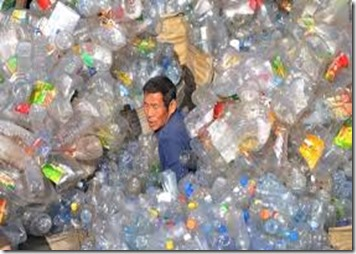 chinese man swimming in plastic bottles