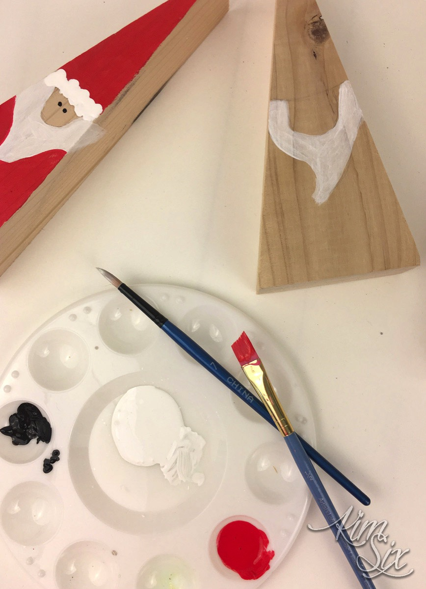 Painting wood triangle santas