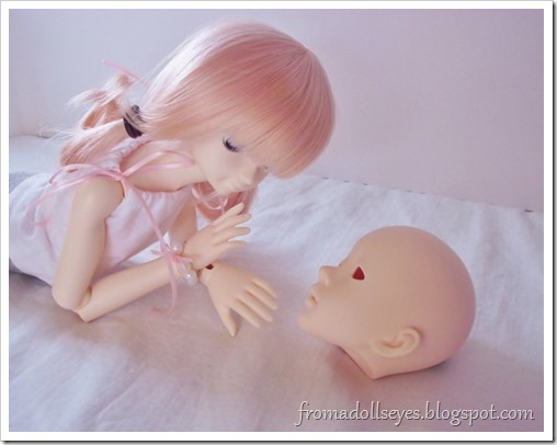 Wordless Wednesday: Time with Friends: A ball jointed doll hanging out with a doll head