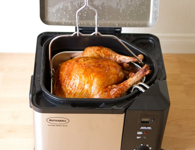 photo of the turkey draining in the fryer
