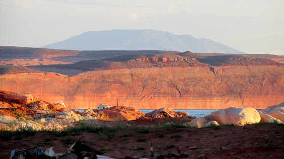 Big wall near Hall's Crossing with Navajo Mountain towering in the distance
