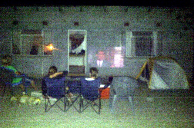 Watching a movie via laptop and projector and wall, in Maun