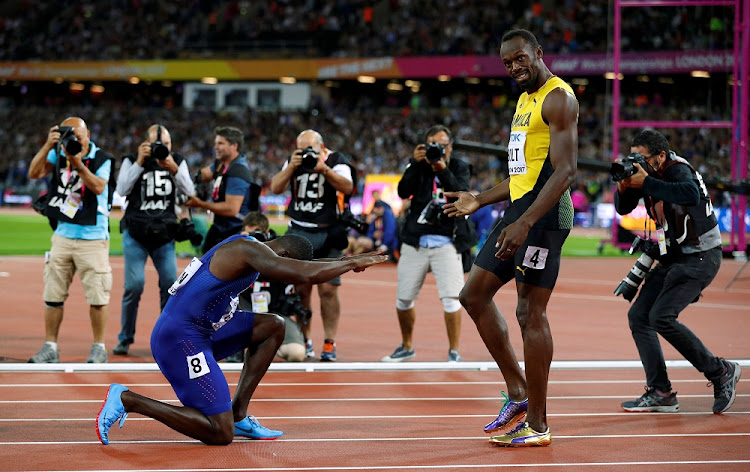 Justin Gatlin of the US bows to outgoing athletics legend Usain Bolt of Jamaica after beating him at the World Athletics Championships 100m final on Saturday. REUTERS