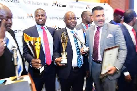 Kiharu Mp Ndindi Nyoro receiving an award from Mizani Africa. PHOTO | BMS