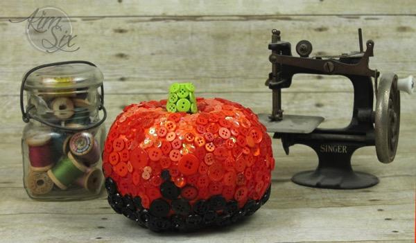Organge and black button pumpkin