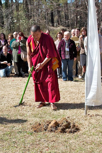 Geshe Gelek breaking ground on the site for the new stupa.
