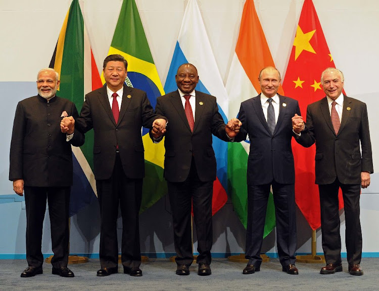 Indian Prime Minister Narendra Modi, Chinese President Xi Jinping, President Cyril Ramaphosa, Russian President Vladimir Putin and Brazilian President Michel Temer pose for a family picture at the 10th Brics summit in Johannesburg, July 26 2018. Picture: SIYABULELA DUDA