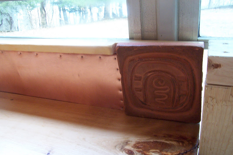 Polyurethane pine counter tops with copper and handmade clay tile back  title=