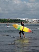 Ted rents a surfboard - Kuta, Bali