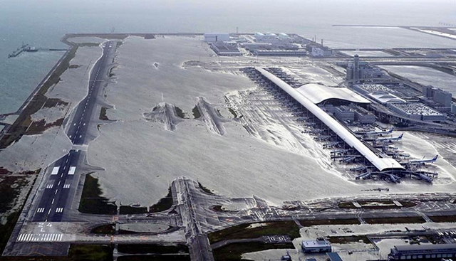 Aerial view of Kansai International Airport on 4 September 2018, after Typhoon Jebi's storm surge inundated one runway and flooded Terminal 1. Photo: Kentaro Ikushima / Mainichi Newspaper / AP