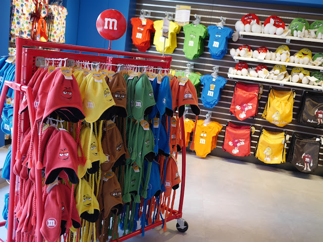 hat and children's clothes for sale at M&M's World in Shanghai