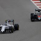 Valtteri Bottas, Williams FW37 Mercedes, leads Fernando Alonso, McLaren MP4-30 Honda