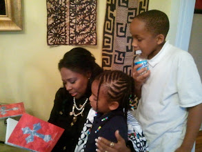 Photo: Jihad & Kaleya listen to Rev. Dr. Marlene L. Garland-Hill read the inscription she wrote for them in her book. (May 4, 2011)