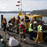 20 April 2012 - Multi-agency working: Firefighters, PHC personnel and Poole lifeboat crews work together to unload essential equipment onto Green Island. Photo: RNLI/Poole Lifeboat Station Anne Millman