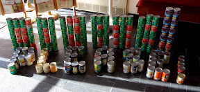 Donate! Please!  (Donate written out vertically in green cans, please written out horizontally)