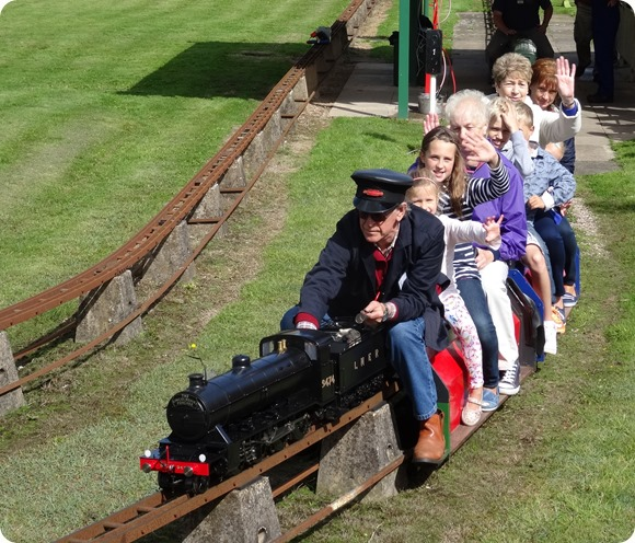 Visitors enjoy a miniature-gauge steam train ride