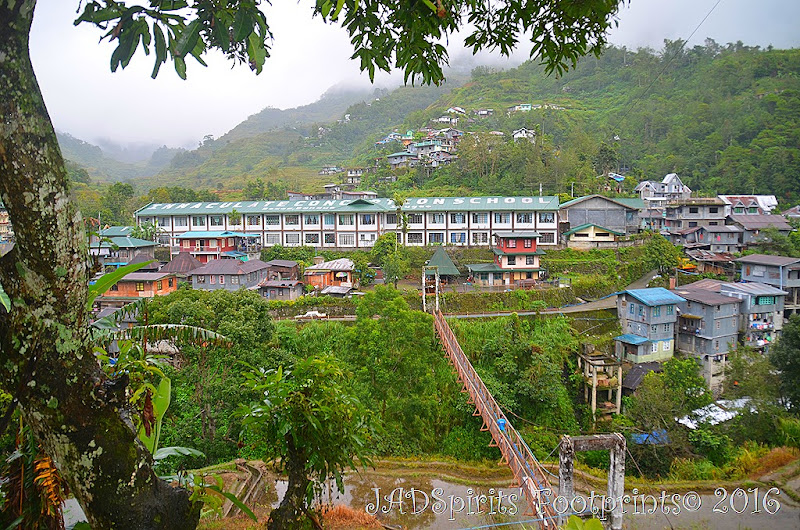 The view of Banaue Hanging Bridge and Immaculate Conception School