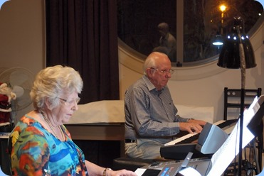 Rob and Barbara Powell played some solos and some duets for us. They brought along their 76 note Tyros 5. Photo courtesy of Dennis Lyons.