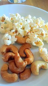 Clyde Common snack, roasted garlic cashews and popcorn with tōgarashi, honey, and butter