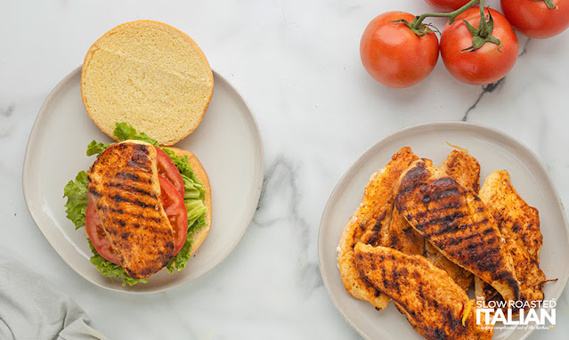 spicy grilled chicken sandwich preparing it on a bun