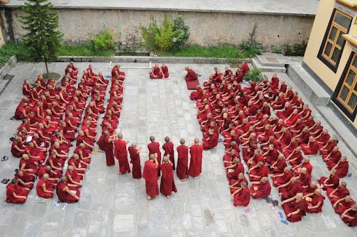 Great debate in Kachoe Ghakyil Nunnery courtyard, Nepal, June 2010. Photo courtesy of Kopan Monastery.