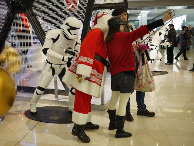 young man and woman posing with Santa Claus at the IAPM shopping center in Shanghai