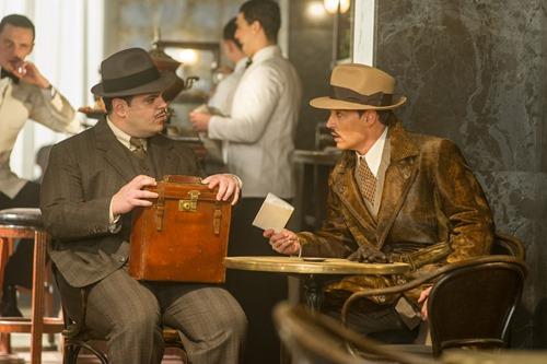 """Josh Gad, left, and Johnny Depp star in Twentieth Century Fox's """"Murder on the Orient Express."""""""