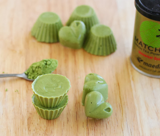 photo of Matcha Chocolates with a canister of matcha powder in the background