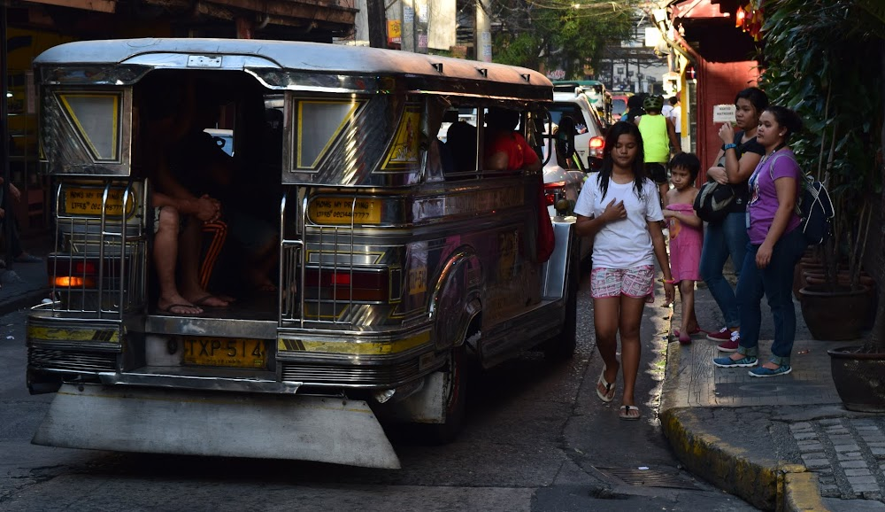 Scenes from Manila... what kind of vehicle is that, you ask?....