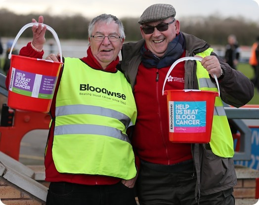 l-r - Ben Reinhardt and Mike Boffey from Bloodwise collect money at the Weaver Stadium on New Years Day 2019
