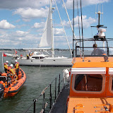 31 May 2011 - Poole ILB preparing to take up the slack of the tow attached to the halyard from the top of the yacht's mast